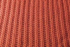 Hand-knotted sweater, fashionable coral color 2019 royalty free stock photo