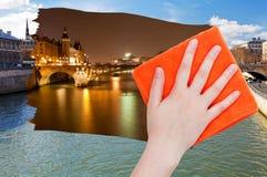 Hand löscht Tagesansicht von Paris durch orange Stoff Stockbild