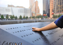 Hand laid on September 11 memorial Stock Photography