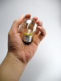 Hand with lamp. My hand hold a lamp stock photography