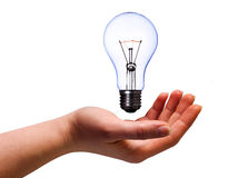 Hand with lamp bulb. Women hand with lamp bulb on white with clipping path Stock Photos
