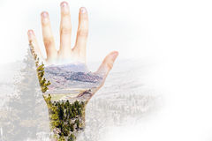 Hand on landscape background. Male hand on abstract landscape background with copy space. Double exposure Stock Images