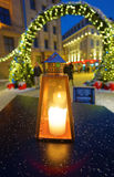 Hand lantern with candle in front of the entrance to the Christm Royalty Free Stock Photos