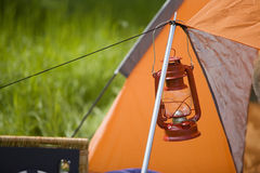 Hand lantern in front of tent Stock Photo