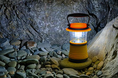 Hand lantern on pebble with boulder, HDR Stock Image