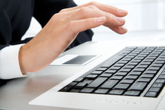Hand and laptop Royalty Free Stock Photo