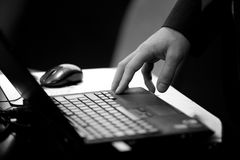 Hand on laptop Royalty Free Stock Photos