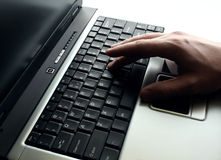 Hand on the laptop Stock Images