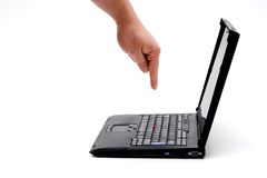 Hand on laptop. Hand pressing key on laptop royalty free stock image