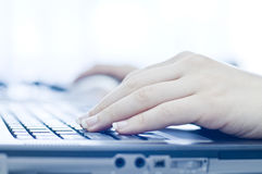 Hand on laptop computer Royalty Free Stock Images