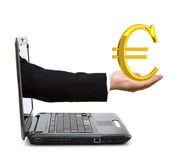 Hand in a laptop with a golden euro symbol. Hand exiting from a laptop and giving a golden euro symbol Stock Image