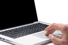 Hand on laptop isolated Stock Photography
