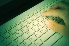 Hand on the laptop keyboard close-up. Business concept. Selective focus. Toned. stock image