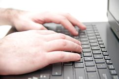 Hand on laptop keyboard Royalty Free Stock Photos