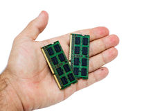 Hand with laptop memory modules Royalty Free Stock Photo