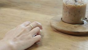 Hand on laptop mouse on wooden table side view. Stock footage stock video footage