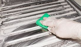 Hand in latex glove duster washing the metal sink. cleaning stock images