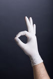 Hand in latex glove Stock Image