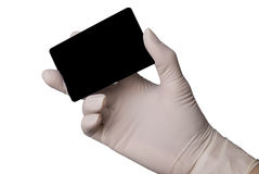 Hand in latex medical glove holding a credit card Royalty Free Stock Photo