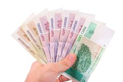 Hand with latvian money Royalty Free Stock Photo