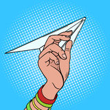 Hand launches paper airplane pop art vector Royalty Free Stock Image