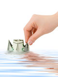 Hand launching money ship Stock Images
