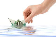 Hand launching money ship Stock Photography