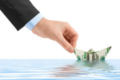 Hand launching money ship Royalty Free Stock Photo