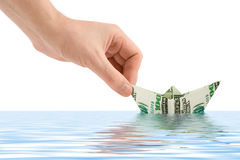Hand launching money ship Royalty Free Stock Images