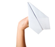Hand launching paper airplane Stock Images
