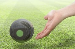 Hand And Lawn Bowl Royalty Free Stock Photo