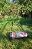 Hand lawnmower in garden Royalty Free Stock Photo