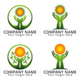 Hand of Leaf with Sun Concept Logo Royalty Free Stock Photos