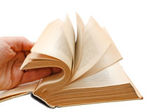 Hand leafing book Stock Images