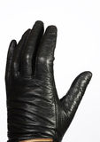 Hand in leather glove Royalty Free Stock Photography