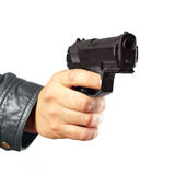 Hand in leather jacket holding gun isolated. On white Stock Images