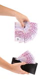 Hand with leather wallet and euro banknotes. Royalty Free Stock Image
