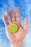 Hand with lemon. Royalty Free Stock Images