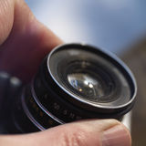 Hand on Lens Stock Image