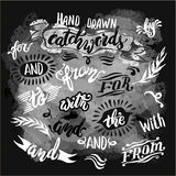 Hand lettered catchwords, drawn with ink and watercolor on grung Royalty Free Stock Images