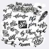 Hand lettered catchwords, drawn with ink and watercolor Stock Images
