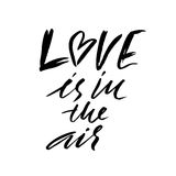 Hand lettered inspirational quote. Love is in the air. Hand brushed ink lettering. Modern brush calligraphy. Vector Stock Photography