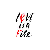 Hand lettered inspirational quote. Love is a fire. Hand brushed ink lettering.. Modern brush calligraphy. Vector illustration Royalty Free Stock Photo