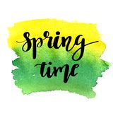 Hand lettered style spring design on a grungy background with green ink blots. Spring Time hand drawn calligraphy letters. Stock Images