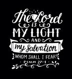 Hand lettering with bible verse The Lord is my light and my salvation, whm shall i fear, made on black background. Psalm. Hand lettering The Lord is my light and Stock Photo