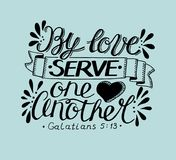 Hand lettering with bible verse By love serve one another on blue background. Hand lettering By love serve one another. Biblical background. Christian poster Royalty Free Stock Image