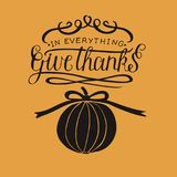 Hand lettering In everything give thanks with pumpkin. royalty free illustration