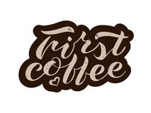 Hand lettering First coffee. Handwritten brush lettering First coffee. Isolated vector illustration text with dark brown strokes on a white background. Lettering Stock Images