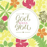 Hand lettering God bless you, is made on a floral background. Stock Image