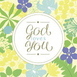 Hand lettering God loves you, is made on a floral background. Christian poster. Card. Congratulations. Modern calligraphy stock illustration